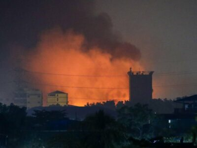 Fire from burning Chinese-owned factories in Myanmar's industrial township of Hlaingthaya, Yangon, March 15, 2021