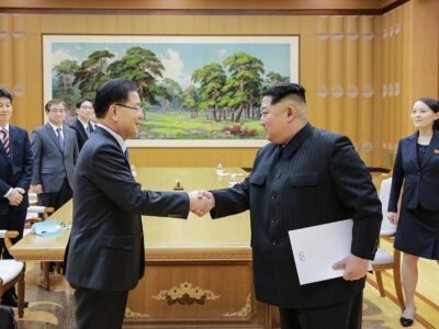 South Korean Chief of the National Security Office Chung Eui-yong (left) and North Korean leader Kim Jong-un meeting at the Workers' Party of Korea in Pyongyang on March 5, 2018. Jong-un is holding a letter signed by SK's president Moon Jae-in to arrange for more talks towards peace. Kim Jong-un's sister, Kim Yo-jong, is on the right.