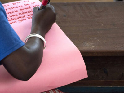 An adolescent girl, rescued from FGM, attends class at a primary school for girls in Uganda. At the school, girls rescued from FGM or child marriage also receive counselling and psychosocial support.